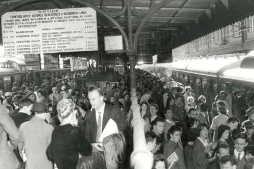 Crowded railway platform at Flinders Street Station, 1960