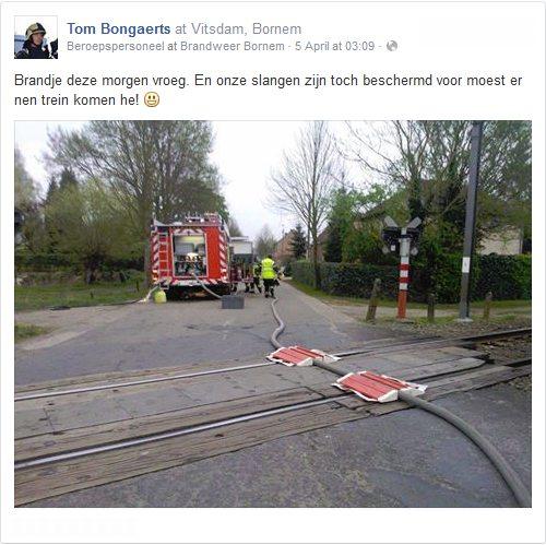 Fire hose over railway tracks (by Tom Bongaerts)