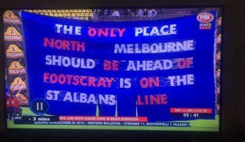 "Western Bulldogs banner - ""The only place North Melbourne should be ahead of Footscray is on the St Albans line"""