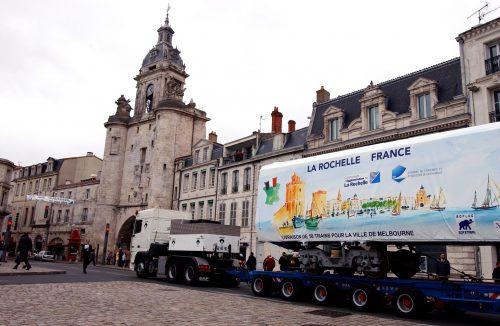 Final X'Trapolis bodyshell in commemorative covering en route for the port of La Rochelle (via Alstom media release May 4th, 2004)